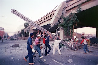 First responders and volunteers help out after the Cypress freeway in Oakland collapsed during the 1989 Loma Prieta earthquake.