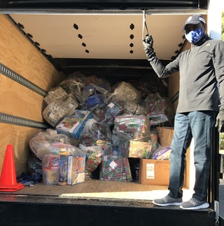 Photo of Head Start truck filled with holiday gifts