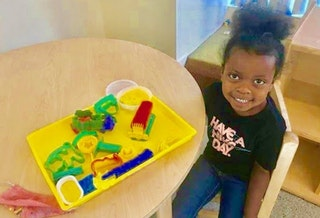 Photo of a Head Start student with toys