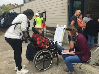 Person with access and functional needs checks into an emergency shelter [Photo Credit: CURBED San Francisco]