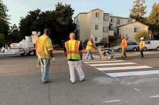 Safe Streets maintenance crews marking a new crosswalk